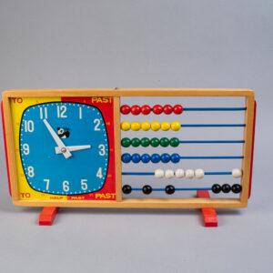 Helmitaulu/kello